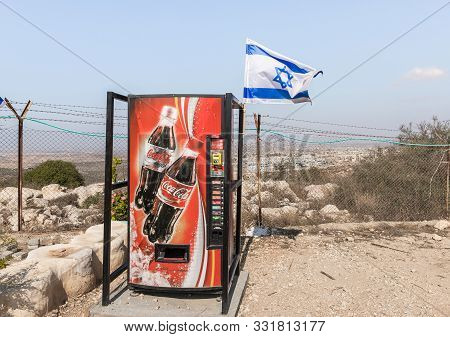 Rosh Haayin, Israel, October 31, 2019 : An Apparatus For The Sale Of Drinks And A Waving Flag Of The