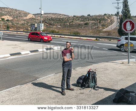 Rosh Haayin, Israel, October 31, 2019 : Young Religious Jew Settler Stands At The Crossroads Awaitin
