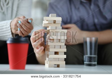 Focus On Wooden Tabletop Game For Several Players. Happy People Spending Quality Time With Relatives