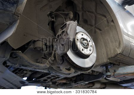 Elements And Design Of The Front Brake Mechanism Of A Modern Car, Brake Caliper, Brake Disc. View Of