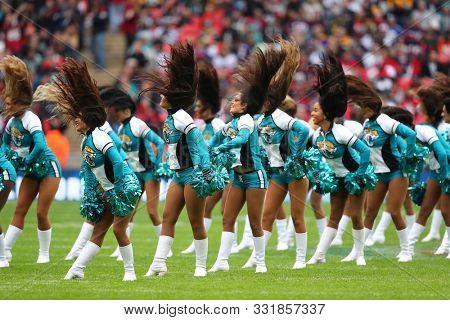 LONDON, ENGLAND - NOVEMBER 03 2019: Jaguars cheerleaders perform during the NFL game between Houston Texans and Jacksonville Jaguars at Wembley Stadium