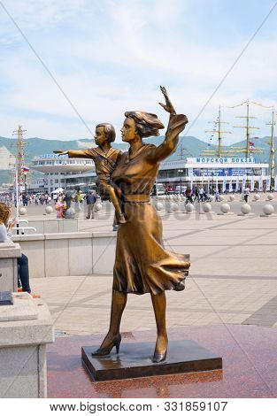 Novorossiysk, Russia - May, 2014: Monument to the wife of a sailor. A bronze sculpture of a woman with a child in her arms, opposite the seaport.