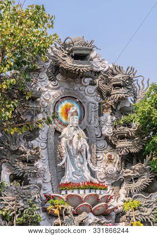 Da Nang, Vietnam - March 10, 2019: Chua An Long Chinese Buddhist Temple. Gray Stone Guan Yin Statue