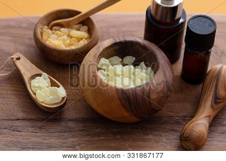 Chios Mastic Tears And Essential Oil On Wood Background