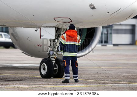 A Ground Control Manager Helps To Park The Aircraft On The Parking Area At The Airport