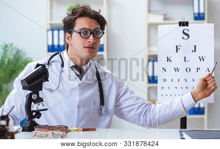 The funny eye doctor in humourous medical concept