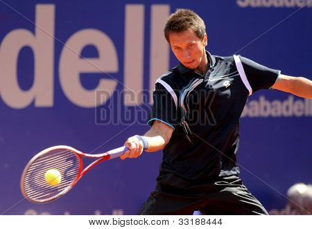 BARCELONA - APRIL, 24: Ukrainian tennis player Sergiy Stakhovsky in action during his match against Andy Murray of Barcelona tennis tournament Conde de Godo on April 24, 2012 in Barcelona
