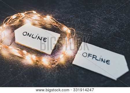 Social Media Lifestyle Concept, Online And Offline Alternatives On Signs Pointing At Opposite Direct
