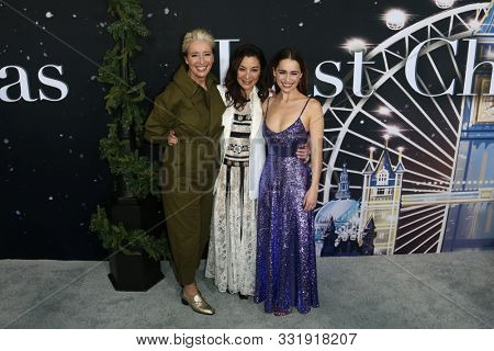 NEW YORK - OCT 29: (L-R) Emma Thompson, Michelle Yeoh and Emilia Clarke attend the Universal Pictures premiere of 'Last Christmas' at AMC Lincoln Square on on October 29, 2019 in New York City.