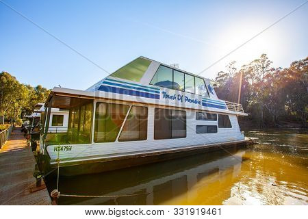 Moama,  Australia - October 3, 2019: Houseboat Moored At Rusty Pier On Murray River