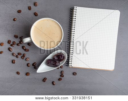 Morning Workplace As Cup Of Coffee, Coffee Beans, Dates And Notepad For Notes. Minimalism Concept
