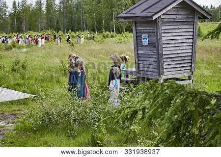 Suomussalmi, Finland - July 24, 2019: View To The Group Of Objects In People Clothes Which Looks Lik