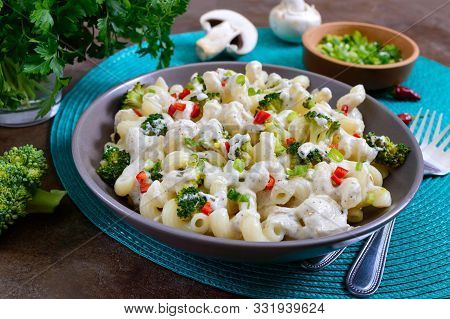 Cavatappi Pasta With Broccoli, Red Pepper And Cream Sauce In A Bowl. Vegetarian Dish. Delicious Heal