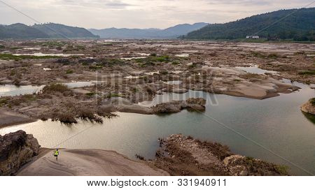 Man Exercise In The Mekong River In The Aerial View