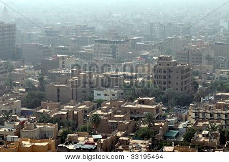 Cityscape of Baghdad, capital of Iraq. Similar buildings with rooftop terraces are typical all over the Middle East.