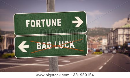 Street Sign The Direction Way To Fortune Versus Bad Luck