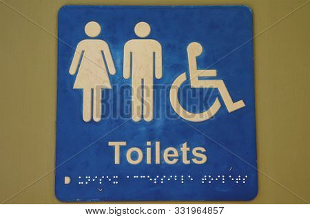 Gender Neutral Wheelchair Accessible Toilet Signage With Braille For The Visually Impaired