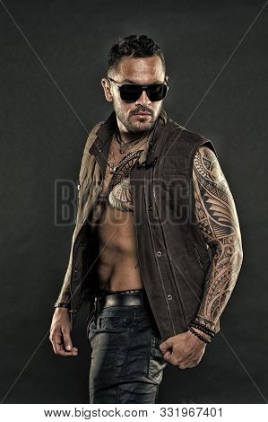 Tattooed Man With Six Pack And Ab. Bearded Man With Tattoo On Chest And Arms. Tattoo Model With Bear