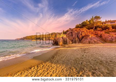 Vourvourou, Chalkidiki Or Halkidiki, Greece Summer Sunset Scenery With Turquoise Sea, Forest Green M