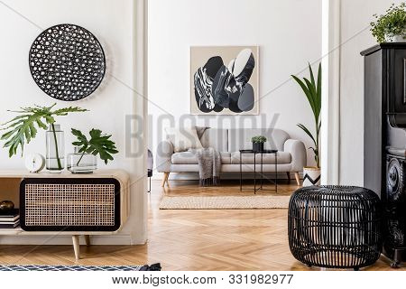 Modern Scandinavian Interior Design Of Open Space With Stylish Wooden Commode, Gray Sofa, Black Pian