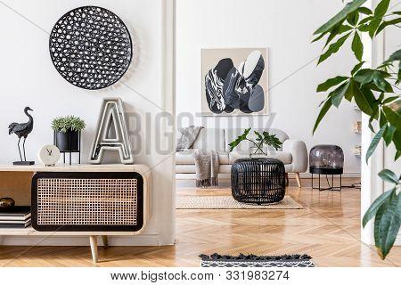 Modern Scandinavian Interior Design Of Open Space With Stylish Wooden Commode, Gray Sofa, Rattan Cof