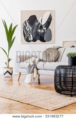 Stylish And Design Home Interior Of Living Room With Gray Sofa, Rattan Table, Lamp, Tropical Leaf, P