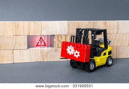 A forklift truck brings a red block to a void in the wall. Repair work, elimination of gaps. Improving system security, fixing errors and bugs. Integration of solutions and problem solving poster