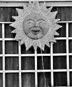 black and white sun fountain with trellis. poster