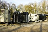 six different horse trailers in grey, black and white poster