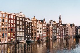 Traditional Old Buildings In Amsterdam, The Netherlands. Authentic Canal Houses In Amsterdam Beautif