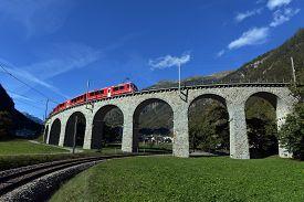 Swiss Mountain Train Bernina Express Passes The Spiral Of The Brusio Viaduct