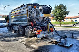 Italy, Caorle,15, April, 2016, Cleaning Truck Pumps Out The Water Drain, Italy, Caorle,15, April, 20
