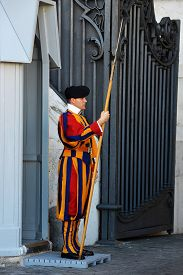 Vatican, Italy - Septembre 26, 2014: Swiss Guard With Nice Uniform Outside In Vatican Streets, Nice