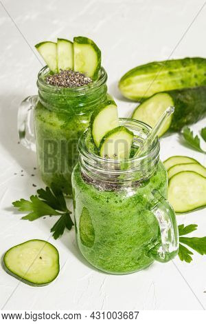 Green Smoothie With Cucumber In A Glass Jar. Fresh Ripe Vegetables, Greens, And Chia Seeds