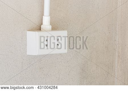 Electrical Socket Plug Or Power Outlet On Cement Wall