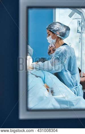 A Snapshot At The Entrance To The Operating Room, Through The Door, Operating Unit, Surgery Performi