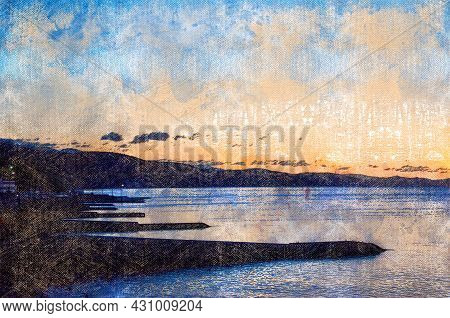 Summer Sunset Over The Sea Beach With Breakwaters. The Shoreline Against The Mountains. Calm Summer