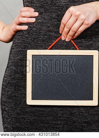 Woman Holding Blank Black Board On Crotch
