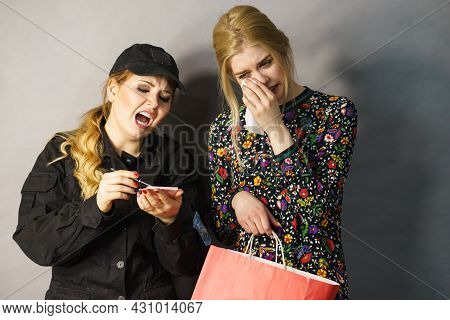 Shoplifting Is A Crime. Teenage Girl Being Caught On Stealing Clothes By Female Security Guard. Cust
