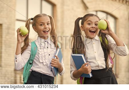 Students Girls Classmates With Backpacks Having School Lunch, Hungry Kids Concept