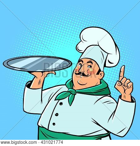 A Chef In A Restaurant With A Tray For Food. A Professional At Work