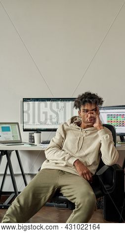 Sad Young Guy, Investor Looking Pensive After Stock Market Failure, Sitting At Desk, Trading Online