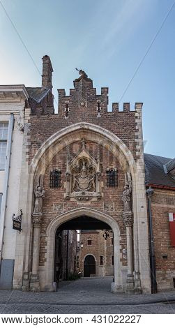 Brugge, Flanders, Belgium - August 4, 2021: Closeup Of Monumental And Sculpted Entrance Gate To Gruu