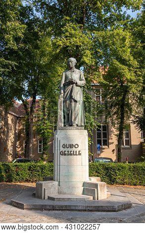 Brugge, Flanders, Belgium - August 4, 2021: Closeup Of Bronze Statue Of Guide Gezelle, Flemish Poet