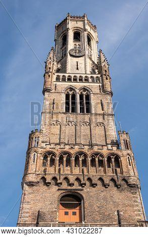 Brugge, Flanders, Belgium - August 4, 2021: Closeup Of Brown Brick Top Half Of Halletoren As Part Of