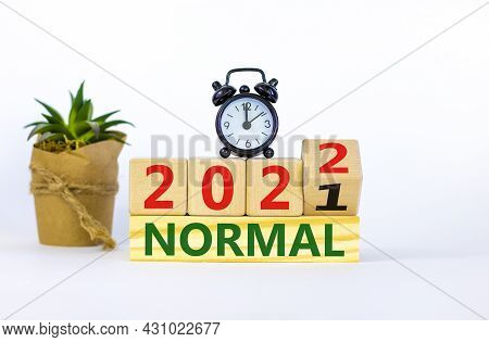 Symbol Of Covid-19 Normal In 2022. Alarm Clock. Turned A Wooden Cube, Changed Words 'normal 2021' To