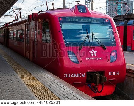 Moscow, Russia - May 26, 2021: Red Electric Train At The Railway Station, The Inscription In Russian