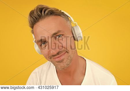 Are You Listening Closely. Middle-aged Man Wear Headphones Yellow Background. English School. Learni