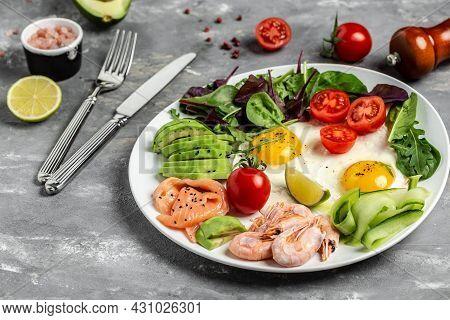 Ketogenic Breakfast. Keto Low Carb Salmon, Boiled Shrimps, Prawns, Fried Eggs, Fresh Salad, Tomatoes