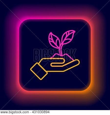 Glowing Neon Line Plant In Hand Of Environmental Protection Icon Isolated On Black Background. Seed